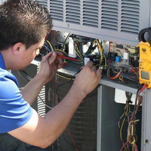 A Technician Repairing an AC.