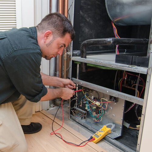 A Technician Testing a Heating System.