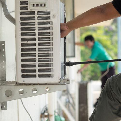 A Technician Cleans AC Coils.