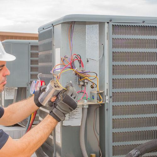 A Technician Installs a Capacitor.